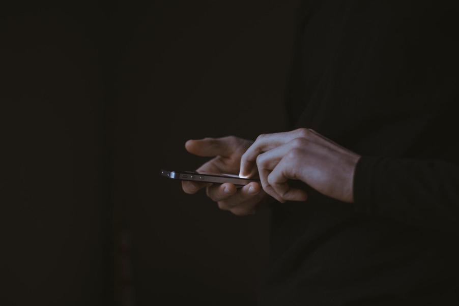 mobile being held
